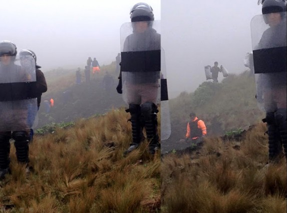 "Peruvian National Police acting as private security for Yanacocha with ""Police"" signs covered in black tape. In the background workers destroying crops and stealing bags of potatoes. Source: solidaritecajamarca.blogspot.fr"
